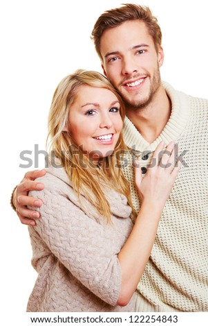 Portrait of young attractive couple looking into the camera - stock photo
