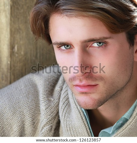portrait of young attractive man with impressive eyes - stock photo