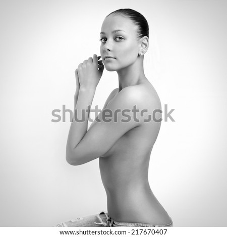 Portrait of young attractive woman. Black and white photo of beautiful woman. - stock photo