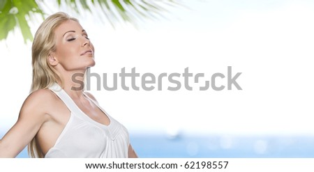 Portrait of young attractive woman having good time  on the beach - stock photo