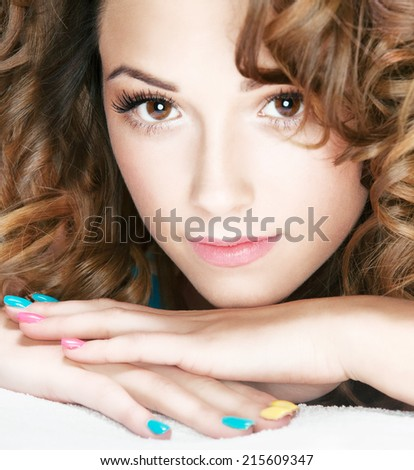 Portrait of young attractive woman lying down in bed - stock photo