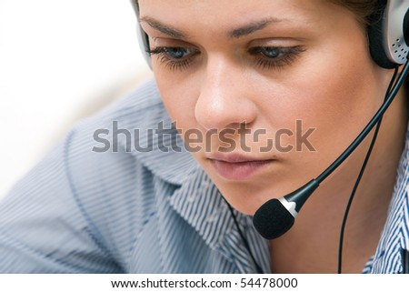 Portrait of young attractive woman working at office. - stock photo