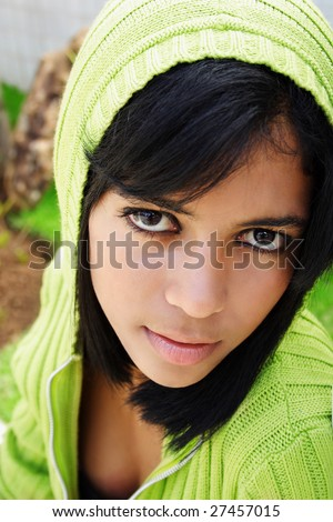 Portrait of young beautiful african american teen girl in green hood. - stock photo