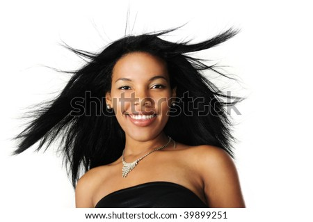 Portrait of young beautiful african american woman with long hair and happy expression - stock photo