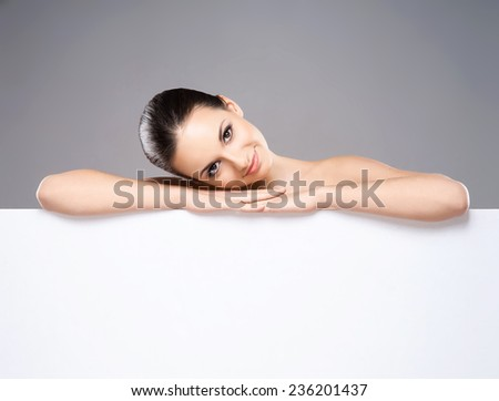 Portrait of young, beautiful and healthy woman with a blank banner - stock photo