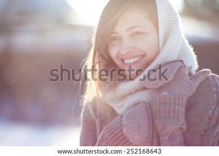 Portrait of young, beautiful and pretty woman in cold sunny winter weather - Outdoor portrait - stock photo