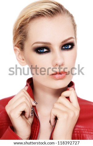 Portrait of young beautiful blond woman with smokey eyes - stock photo