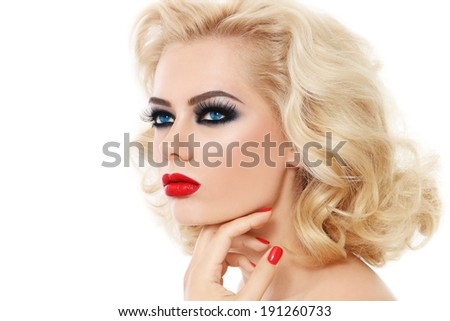 Portrait of young beautiful blond woman with smoky eyes and red lips over white background - stock photo