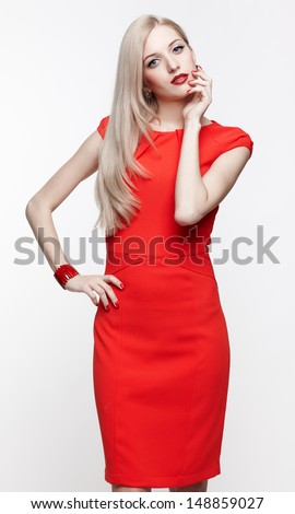 portrait of young beautiful blonde woman in red dress and red bracelet - stock photo
