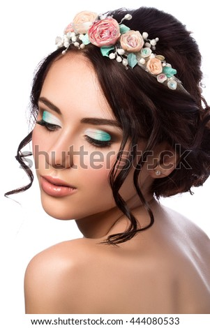 Portrait of young beautiful bride. Wedding coiffure and make-up. Studio shot - stock photo