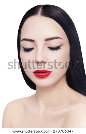 Portrait of young beautiful brunette with cat eyes eyeliner and red lipstick over white background - stock photo