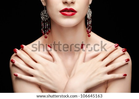 portrait of young beautiful brunette woman in jewelry with manicured hands on her chest - stock photo