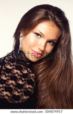 Portrait of Young Beautiful Brunette Woman with Jewelry Ring. Healthy Long Hair and Clean Skin - stock photo