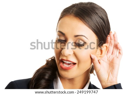 Portrait of young beautiful businesswoman overhears. - stock photo