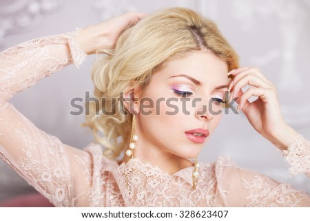 Portrait of young beautiful caucasian blond girl in gorgeous dress  - stock photo