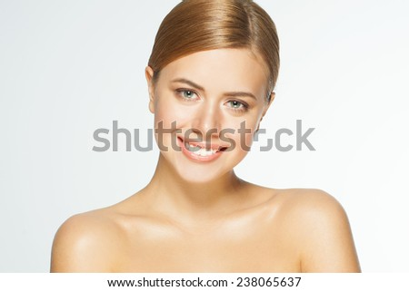 Portrait of young beautiful caucasian woman. Beauty care concept of beautiful caucasian female model  with healthy skin, isolated on white background. - stock photo