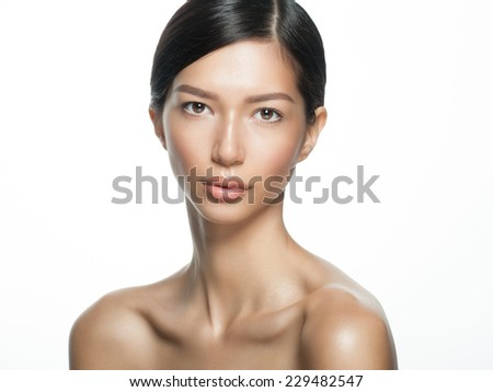 Portrait of young beautiful ethnic woman. Beauty care concept of beautiful mixed race Asian Caucasian female model  isolated on white background. - stock photo