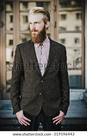 Portrait of young beautiful fashionable man outdoor - stock photo