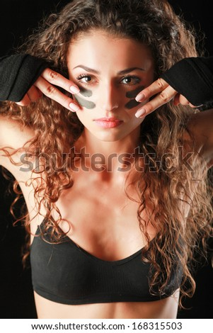 Portrait of young beautiful fitness woman, isolated on black background - stock photo
