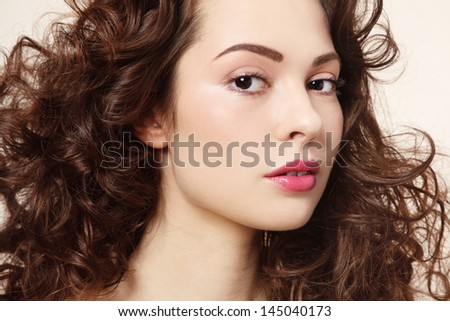 Portrait of young beautiful fresh girl with long curly hair - stock photo