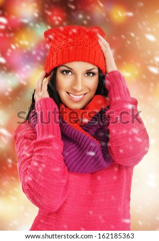Portrait of young beautiful girl in winter style over Christmas background - stock photo