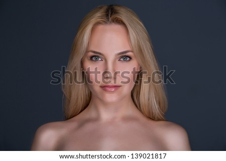 Portrait of young beautiful girl on dark background - stock photo