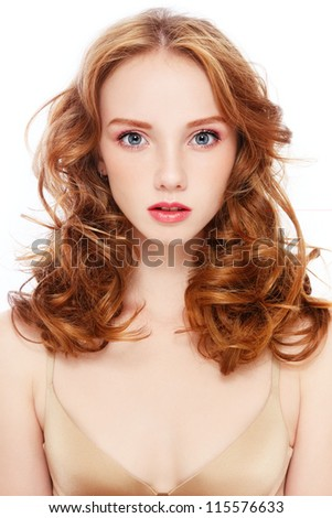 Portrait of young beautiful girl with curly red hair on white background - stock photo