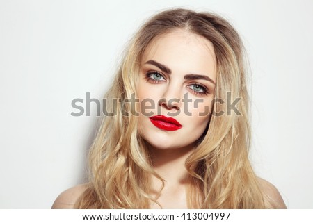 Portrait of young beautiful girl with long messy hair and red lips - stock photo