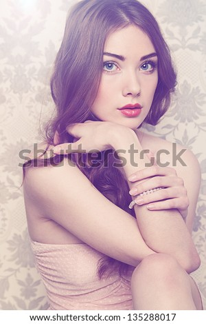 Portrait of young beautiful girl with wavy hair. Fashion photo - stock photo