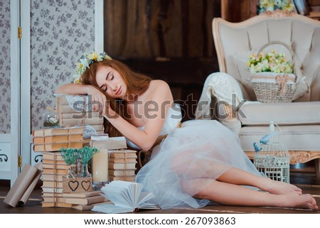 Portrait of young beautiful rude princess girl with flower wreath and books in rustic wood vintage interior - stock photo