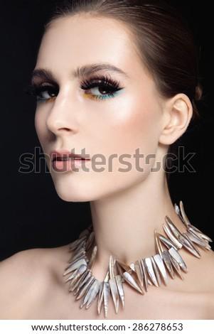 Portrait of young beautiful slim woman with stylish make-up and false eyelashes - stock photo