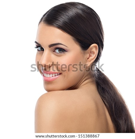 Portrait of young beautiful smiling woman on white background - stock photo