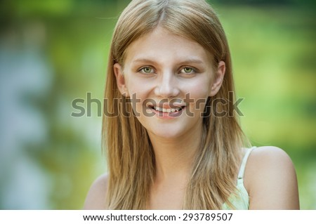 Portrait of young beautiful woman against lake with bridge. - stock photo