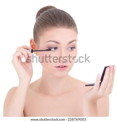 portrait of young beautiful woman applying mascara on her eyelashes isolated on white background - stock photo