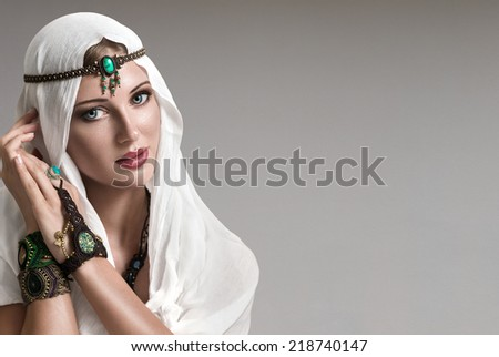 Portrait of young beautiful woman arabic style fashion look - stock photo