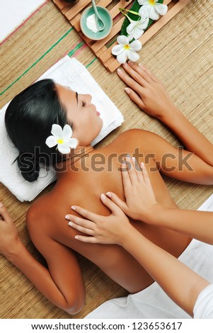 portrait of young beautiful woman  back  in spa environment - stock photo