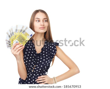 Portrait of young beautiful woman holding euro banknotes money looking away isolated on white background - stock photo
