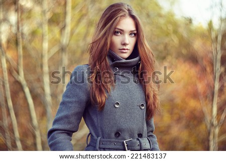 Portrait of young beautiful woman in autumn coat. Fashion photo - stock photo