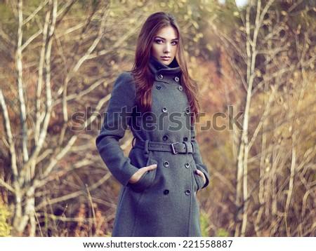 Portrait of young beautiful woman in autumn coat. Fashion photo - stock photo