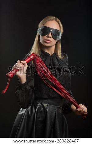 Portrait of young beautiful woman in blindfold - stock photo