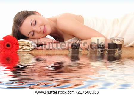 portrait of young beautiful woman in spa environment. - stock photo