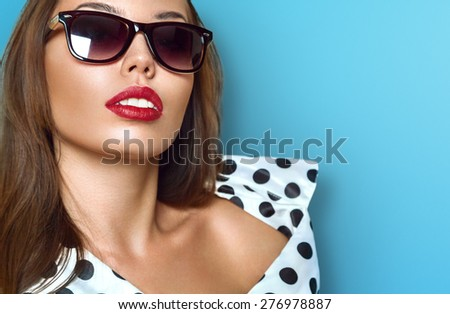 Portrait of young beautiful woman in sun glasses with perfect tanned skin - stock photo