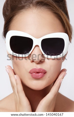 Portrait of young beautiful woman in vintage sunglasses - stock photo
