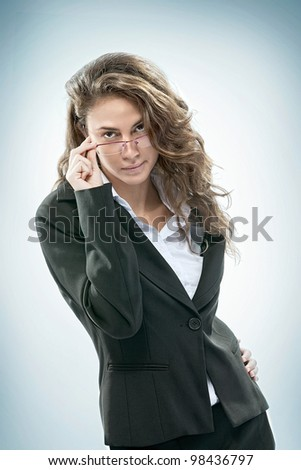 Portrait of young beautiful woman  on blue  back - stock photo
