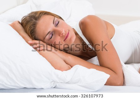 Portrait Of Young Beautiful Woman Sleeping In Bed - stock photo