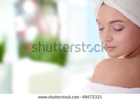 Portrait of young beautiful woman wearing bathrobe - stock photo