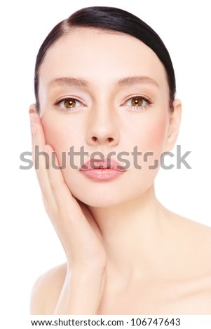 Portrait of young beautiful woman with clear make-up touching her face, over white background - stock photo