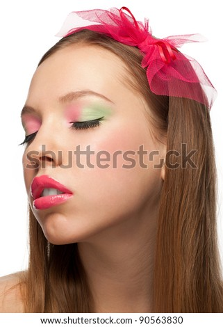 Portrait of young beautiful woman with closed eyes and stylish make-up. Girl with pink bow in her hair - stock photo