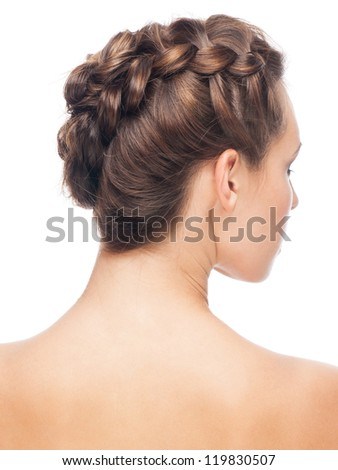 Portrait of young beautiful woman with creative braid hairdo. Rear view, isolated on white background - stock photo