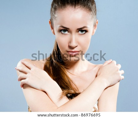 Portrait of young beautiful woman with fresh clean skin - - stock photo